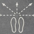 Footprints with arrows pointing in various directions