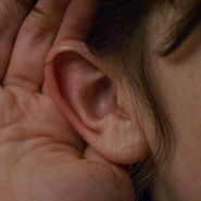 Hand cupping ear